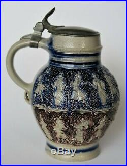 A very nice and interesting Antique Westerwald Stoneware jug stein dancing