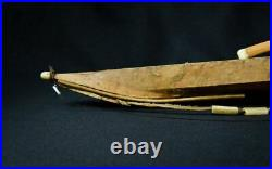 Antique Eskimo Kayak with figure and implements very nice. Early 20th century