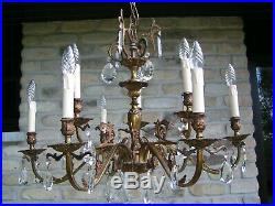Very nice and fabulous vintage 9 lt aged brass chandelier with shining drops