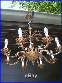 Very nice ornated vintage 8 lt aged brass chandelier. Look @ this 1