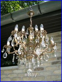 Very nice ornated vintage French 12 lt chandelier with shining drops. Look!